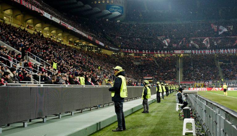 Stewards facing the crowd at a European Football match