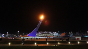 The Olympic flame will shine in front of a smaller crowd, as fan capacity for the Olympics will be reduced.